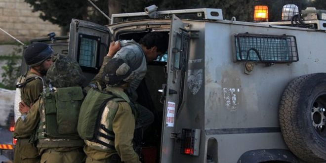 Occupation forces arrest two Palestinians in the West Bank