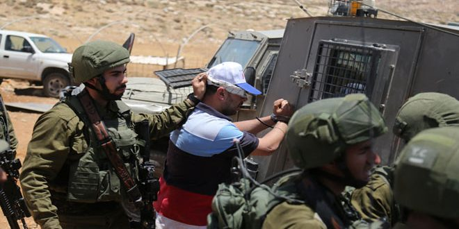 Israeli occupation troops arrest two Palestinians in the West Bank