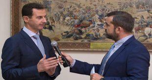 presidente al-Assad al canal griego ETV