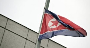 The flag of the Democratic Republic of Korea (DPRK - North Korea) flies at half-mast in front of the embassy in Berlin December 19, 2011, following the death of North Korean leader Kim Jong-Il. The German government said that the death of North Korean leader Kim Jong-Il offered a chance for positive change in the impoverished, nuclear-armed and deeply isolated nation.      AFP PHOTO / JOHN MACDOUGALL (Photo credit should read JOHN MACDOUGALL/AFP/Getty Images)