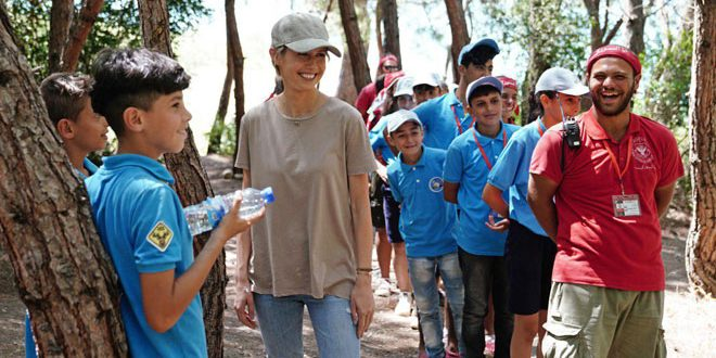 "Mrs. Asma al-Assad visits camp of ""the adolescent explorers"" in Lattakia countryside"