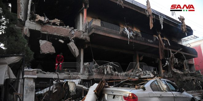 2 martyred, 10 injured in hostile missile attack on residential building in Damascus
