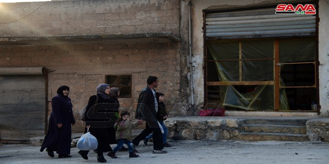 Locals inspect their houses in Hayyan, Hraitan towns in Aleppo countryside after liberation from terrorism