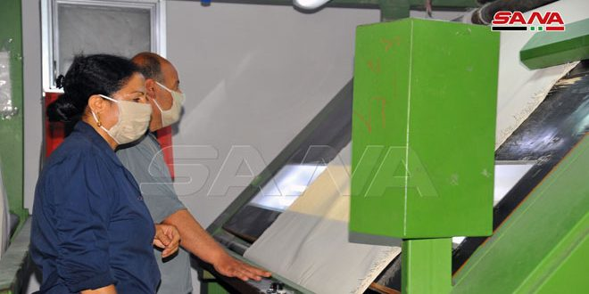 Workers at Lattakia Textile Company continue production to provide local market with its needs