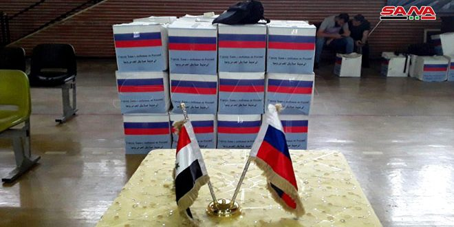 Syrian-Russian business council provides aids to families affected by terrorism in Hama