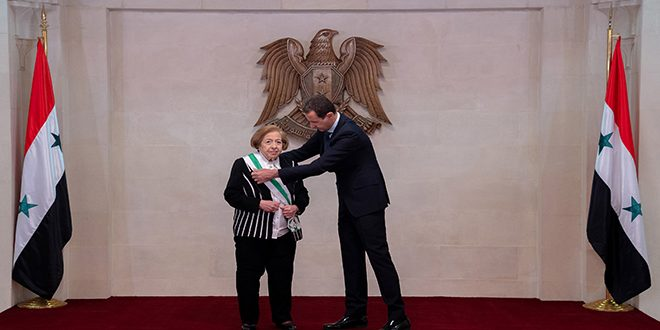 President Al – Assad awards Syrian Order of Merit to Director General of Commission of Martyrs' sons schools