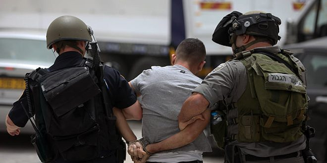 Israeli occupation forces arrest a Palestinian in Bethlehem