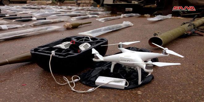 Hallan un drone y armas de terroristas en fincas de Deraa al Balad