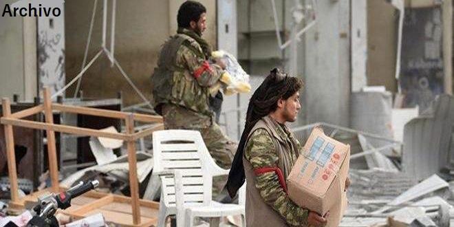 El trigo y las propiedades saqueadas de los sirios se venden en Turquía por mercenarios proturcos