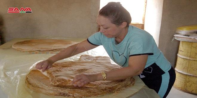En fotos: Elaboración del pan árabe (Mashruh) en la provincia sureña de Swaida