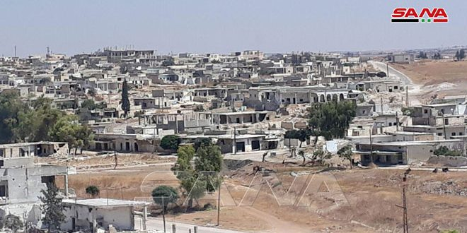 Съемочная группа агентства САНА вместе с армейцами в освобожденном поселке Аль-Латамна провинции Хама