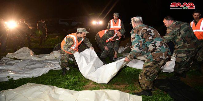 Teröristlerin Doğu Guta'daki El Ubb Çiftliklerinde İdam Ettiği Bazı Şehit Cesetlerini İçeren Toplu Mezar Bulundu