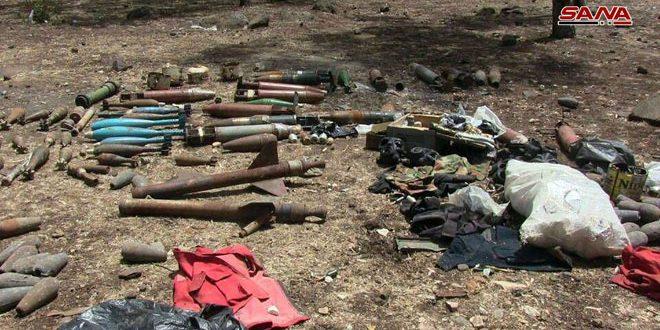 الجهات المختصة تعثر على رشاشات وقذائف صاروخية وهاون وألغام متنوعة من مخلفات الإرهابيين في قرية الغنطو بريف حمص