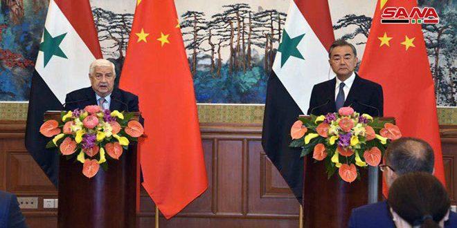 المعلم: سيتم القضاء على الإرهاب في إدلب… وانغ يي: سنواصل دعم سورية في حربها على الإرهاب
