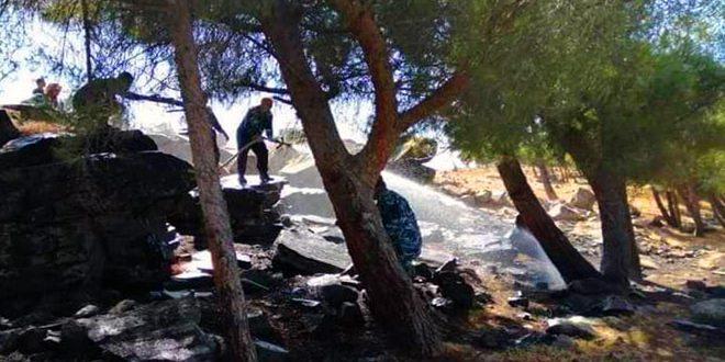 إخماد حريق في حراج موقع جبل العيور في ريف سلمية الشمالي الغربي